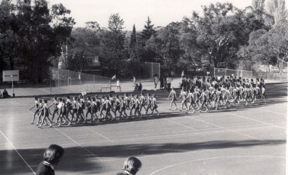 Image for photo: 1976 Marching on tennis court Senior School.jpg
